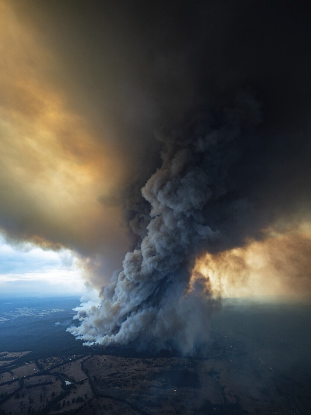 In this image released Thursday, Jan. 2, 2020, from the Department of Environment, Land, Water and Planning in Gippsland, Australia, a massive smoke r...
