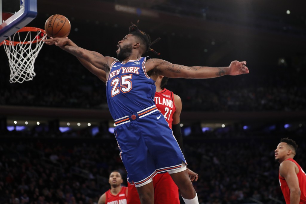 Portland Trail Blazers center Hassan Whiteside (21) interrupts a shot by New York Knicks guard Reggie Bullock (25) during the second half of an NBA ba...