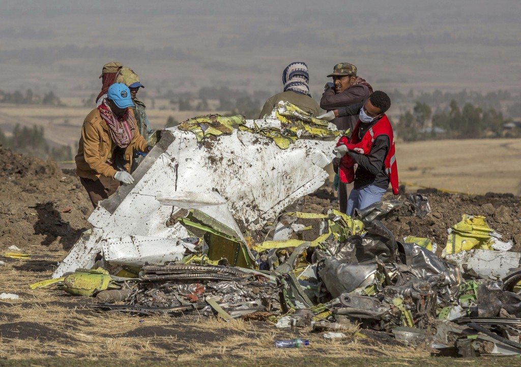 FILE - In this file photo dated Monday, March 11, 2019, rescuers work at the scene of an Ethiopian Airlines plane crash south of Addis Ababa, Ethiopia...