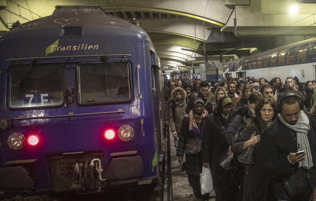 Commuters arrive at at Gare Montparnasse train station during the 29th day of transport strikes in Paris, Thursday, Jan. 2, 2020. The start of 2020 wa...