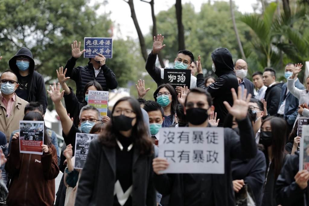 Protesters hold up their hands to represent their five demands during a rally in Hong Kong Thursday, Jan. 2, 2020. Hundreds of thousands of people pac...