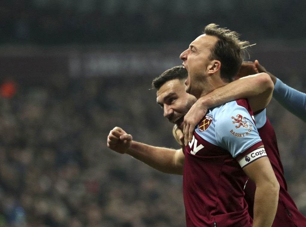 West Ham United's Mark Noble, celebrates scoring his side's first goal of the game against Bournemouth, during their English Premier League soccer mat...