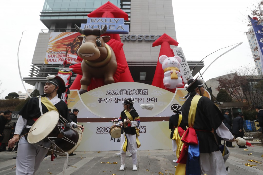 Dancers in traditional costumes perform to celebrate the opening of this year's trading in Seoul, South Korea, Thursday, Jan. 2, 2020. Asian shares we...