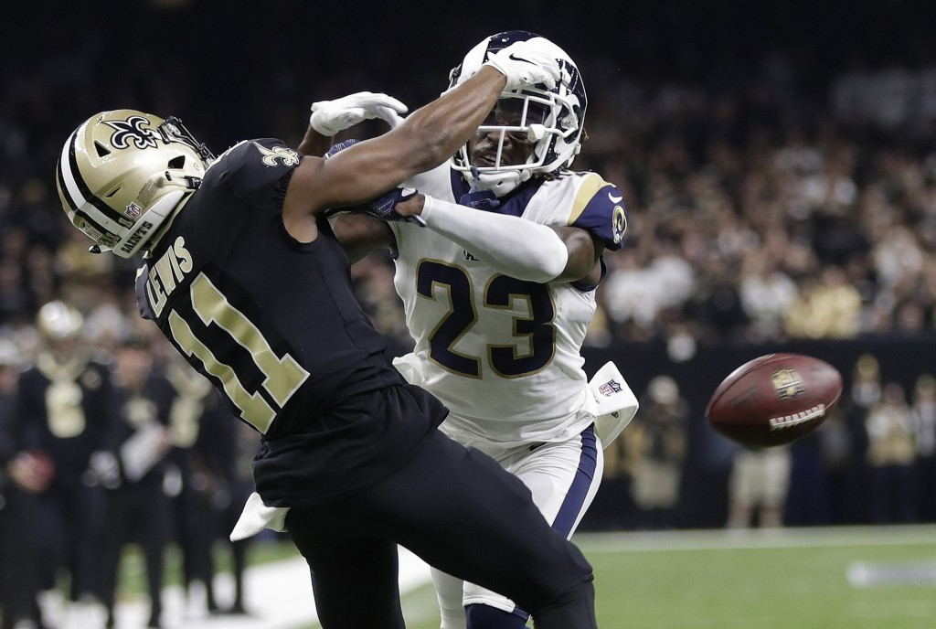 FILE - In this Jan. 20, 2019, file photo, Los Angeles Rams' Nickell Robey-Coleman breaks up a pass intended for New Orleans Saints' Tommylee Lewis dur...