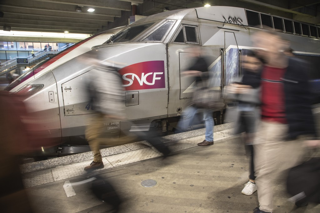 Travelers arrive at at Gare Montparnasse train station during the 29th day of transport strikes in Paris, Thursday, Jan. 2, 2020. The start of 2020 wa...