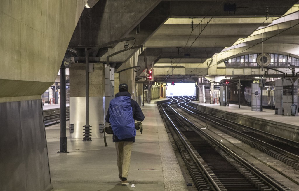 A raveler walks on a empty platform at at Gare Montparnasse train station during the 29th day of transport strikes in Paris, Thursday, Jan. 2, 2020. T...