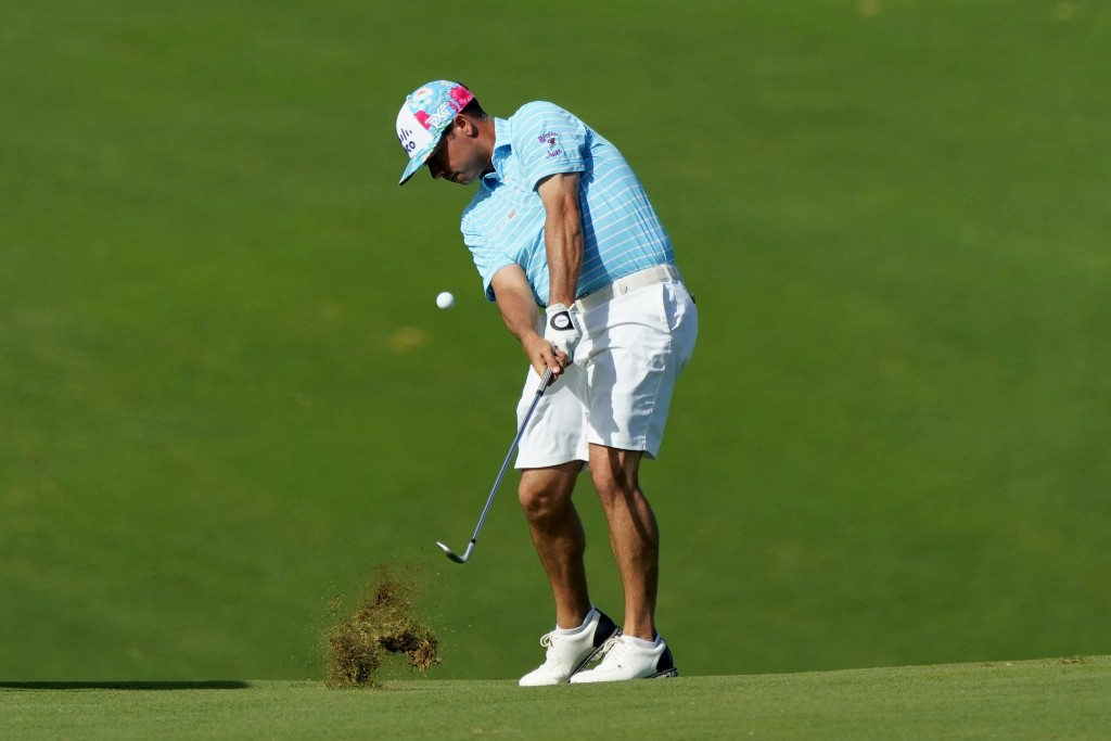 Chez Reavie hits his approach shot from the ninth fairway during the Tournament of Champions pro-am golf event, Wednesday, Jan. 1, 2020, at Kapalua Pl...