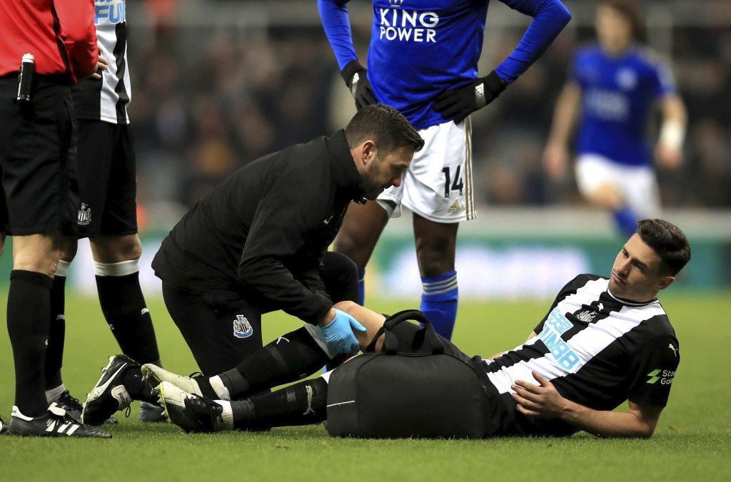 Newcastle United's Fabian Schar receives treatment during the English Premier League soccer match between Newcastle United and Leicester City at St Ja...