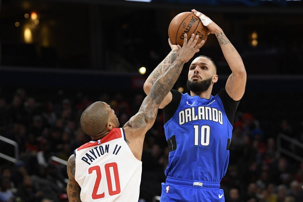 Orlando Magic guard Evan Fournier (10) shoots as Washington Wizards guard Gary Payton II (20) defends during the first half of an NBA basketball game ...