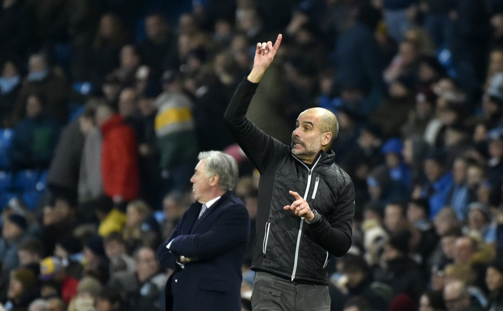 Manchester City's head coach Pep Guardiola, right, and Everton's manager Carlo Ancelotti react during the English Premier League soccer match between ...
