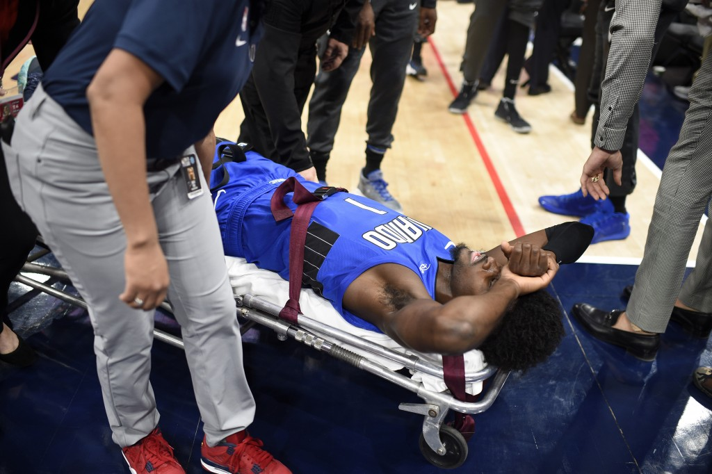 Orlando Magic forward Jonathan Isaac is taken off the court on a stretcher after he sustained an injury during the first half of the team's NBA basket...