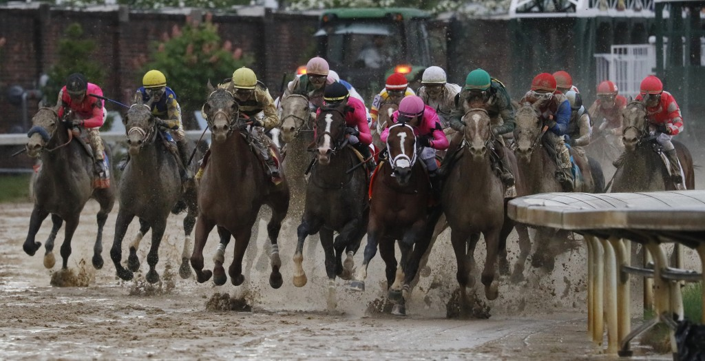 FILE - In this May 4, 2019, file photo, Luis Saez rides Maximum Security, second from right, during the 145th running of the Kentucky Derby horse race...