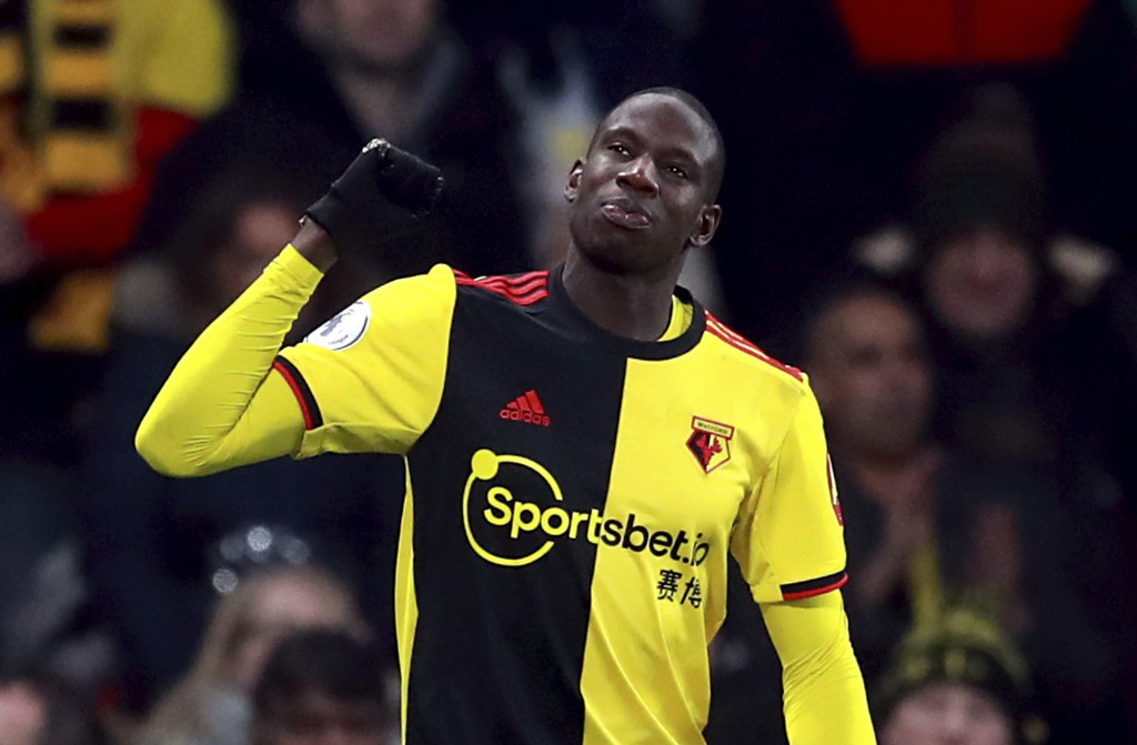 Watford's Abdoulaye Doucoure celebrates scoring his side's second goal of the game, during the English Premier League soccer match between Watford and...