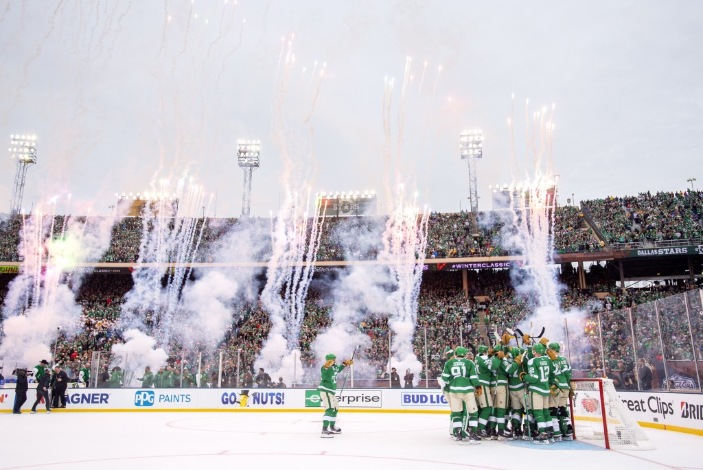 The Dallas Stars celebrate their 4-2 victory over the Nashville Predators at the end of the NHL Winter Classic hockey game at the Cotton Bowl, Wednesd...