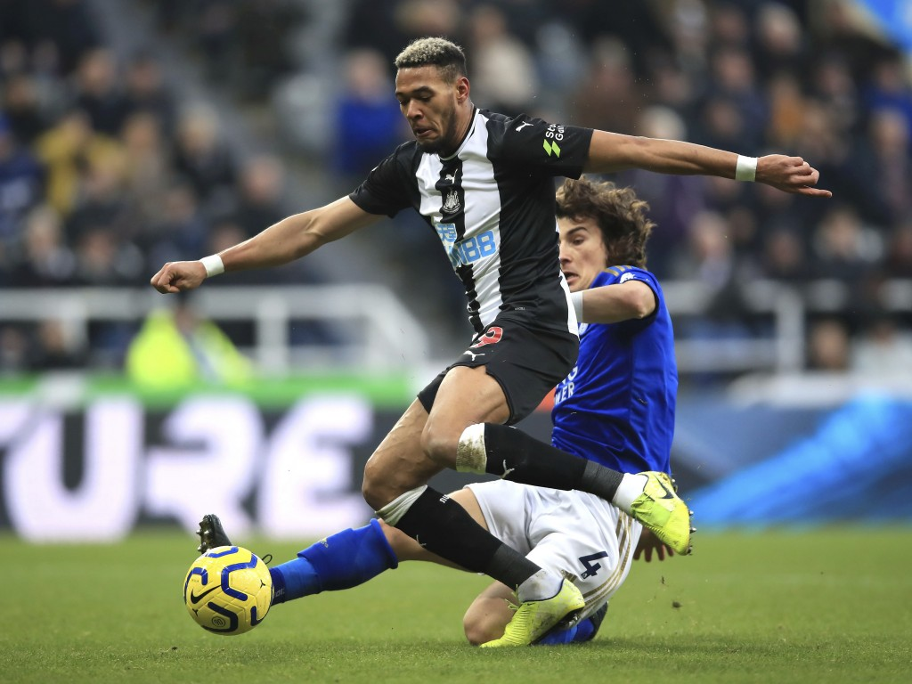 Newcastle United's Joelinton, left and Leicester City's Caglar Soyuncu battle for the ball during the English Premier League soccer match between Newc...