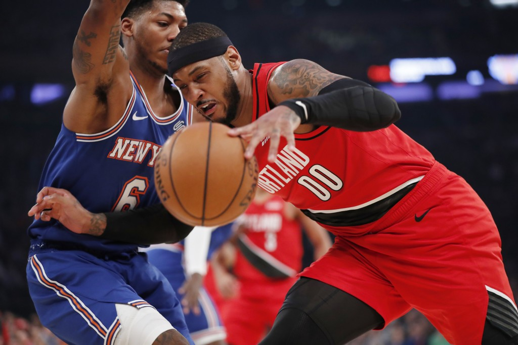Portland Trail Blazers forward Carmelo Anthony (00) loses control of the ball as New York Knicks guard Elfrid Payton (6) tries to block Anthony's prog...