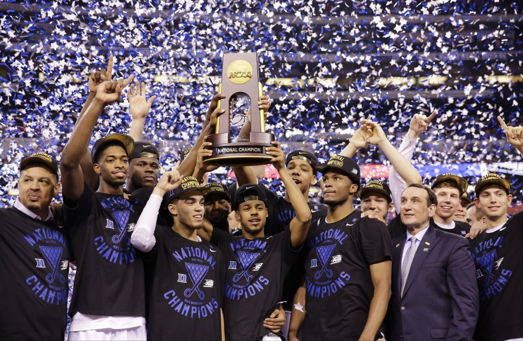 FILE - In this April 6, 2015, file photo, Duke players celebrate with the trophy after their 68-63 victory over Wisconsin in the NCAA Final Four colle...