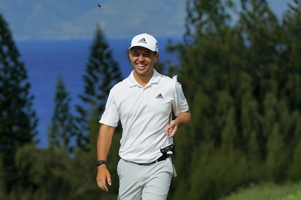 Defending Champion Xander Schauffele smiles during the Tournament of Champions pro-am golf event, Wednesday, Jan. 1, 2020, at Kapalua Plantation Cours...