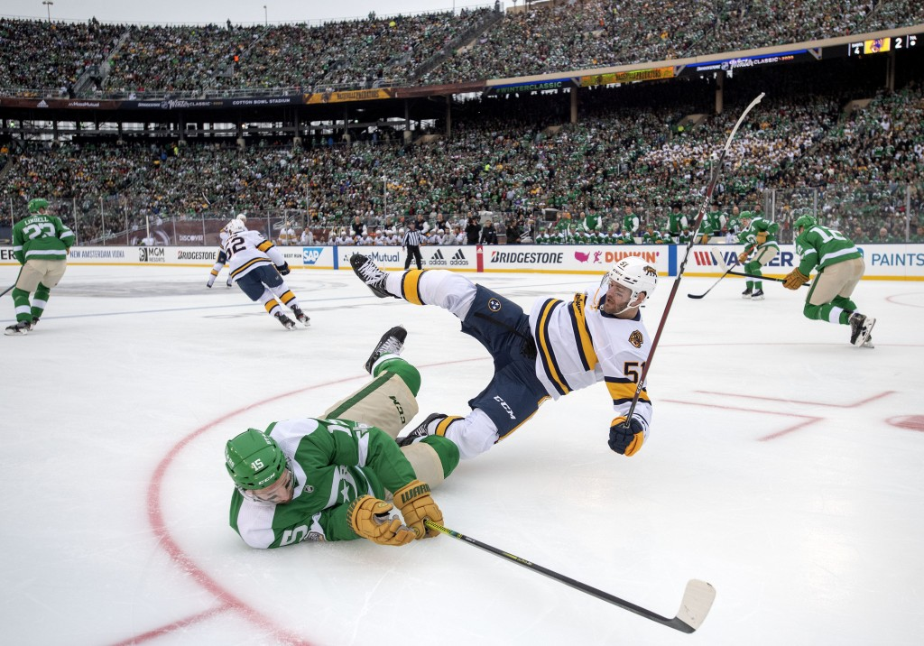 Dallas Stars left wing Blake Comeau (15) falls to the ice after being checked by Nashville Predators left wing Austin Watson (51) in the first period ...