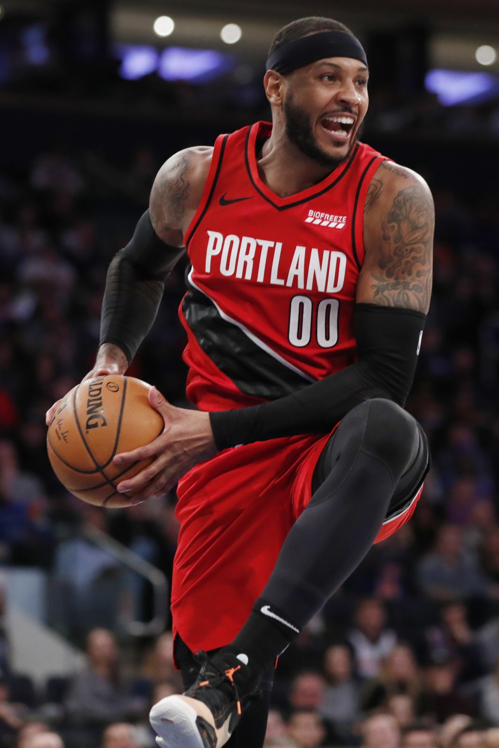 Portland Trail Blazers forward Carmelo Anthony pulls down a rebound during the second half of the team's NBA basketball game against the New York Knic...