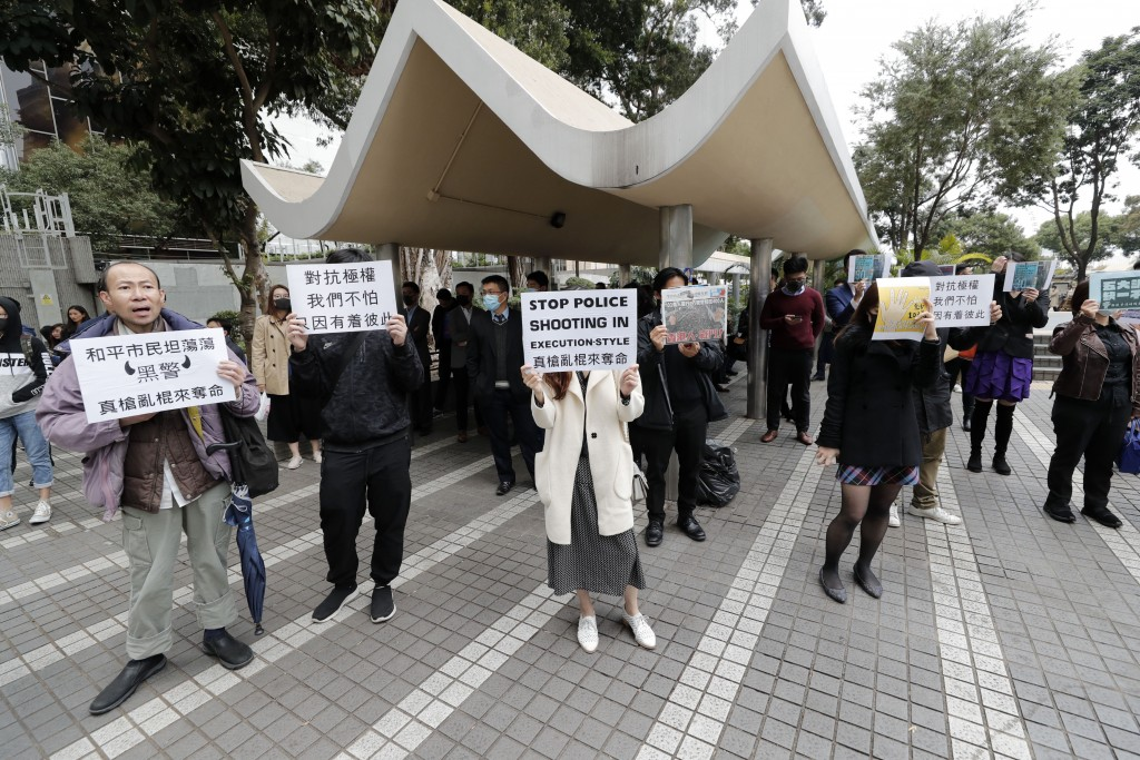 Protesters hold up placards during a rally in Hong Kong  Thursday, Jan. 2, 2020. Hundreds of thousands of people packed Hong Kong streets for an annua...