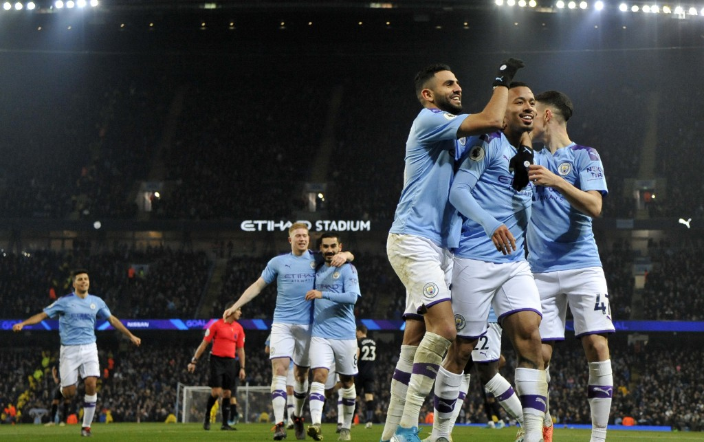 Manchester City's Gabriel Jesus, second right, celebrates with teammates after scoring his side's opening goal during the English Premier League socce...