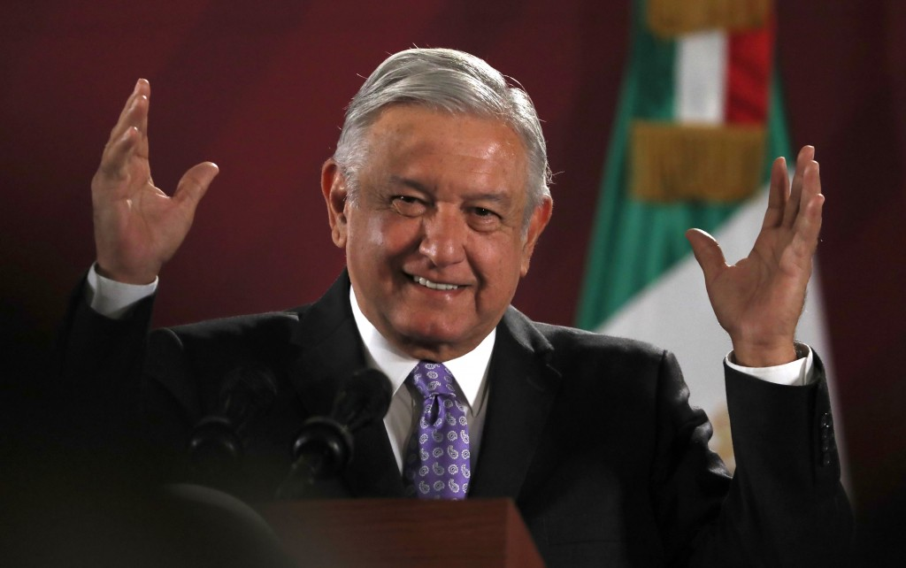 FILE In this Nov. 13, 2019 file photo, Mexican President Andres Manuel Lopez Obrador smiles during his daily morning news conference at the National P...