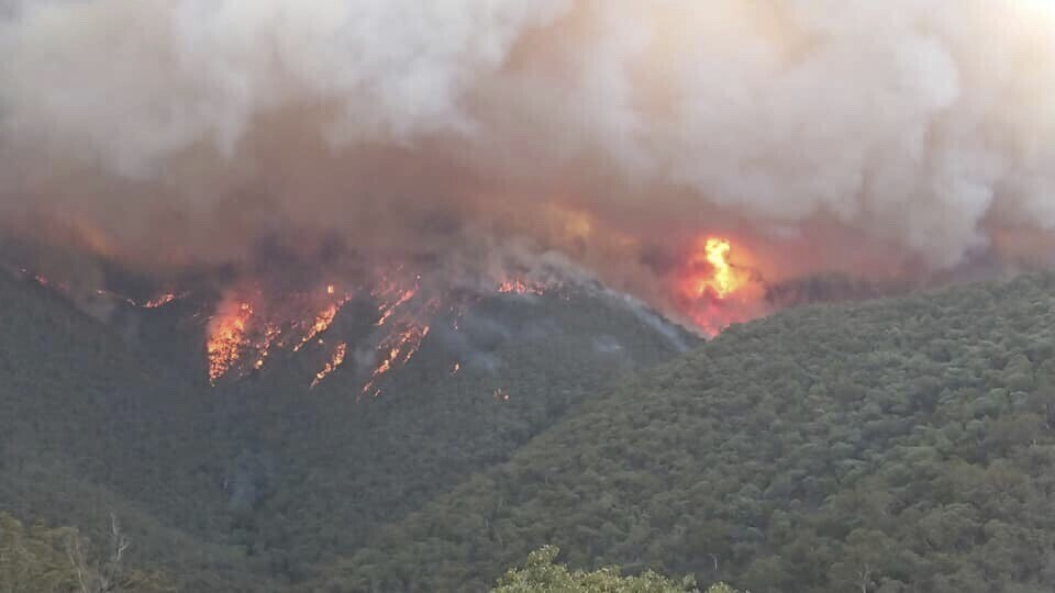 In this image released Thursday, Jan. 2, 2020, from the Department of Environment, Land, Water and Planning in Gippsland, Australia, smoke rises from ...