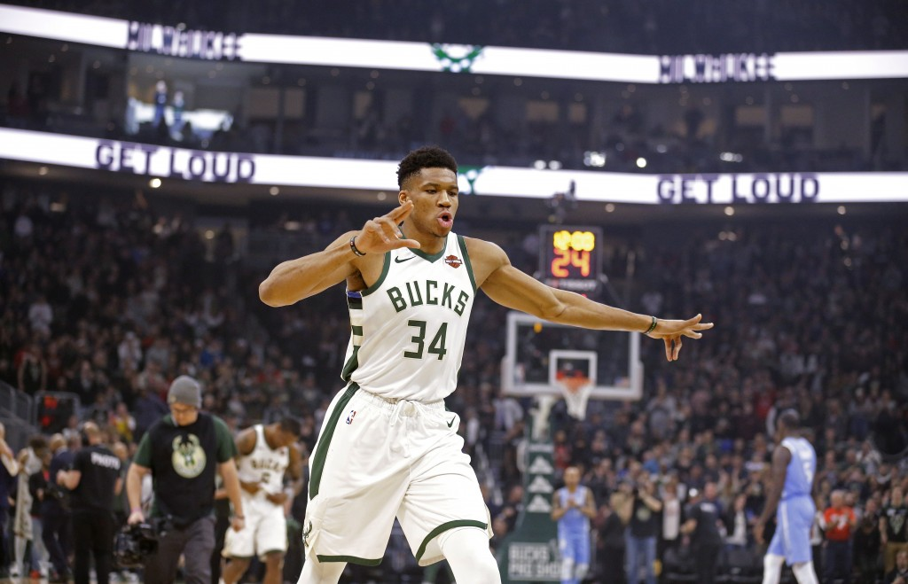 Milwaukee Bucks' Giannis Antetounmpo gets ready for the opening tip of the team's NBA basketball against the Minnesota Timberwolves on Wednesday, Jan....