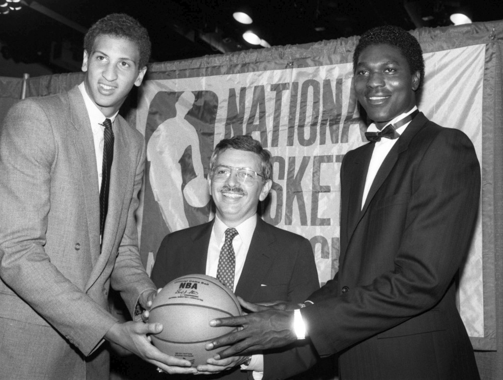 FILE - In this June 19, 1984 file photo, NBA commissioner David Stern, center, is flanked by Akeem Olajuwon, right, the No. 1 pick overall by the Hous...