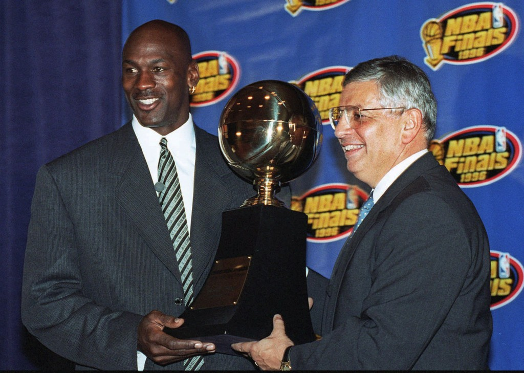 FILE - In this June 18, 1996, file photo, Chicago Bulls' Michael Jordan, left, receives the NBA Finals Most Valuable Player trophy from Commissioner D...