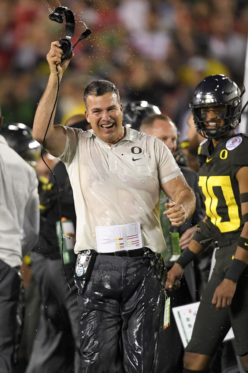 Oregon head coach Mario Cristobal celebrates after their win against Wisconsin in the Rose Bowl NCAA college football game Wednesday, Jan. 1, 2020, in...