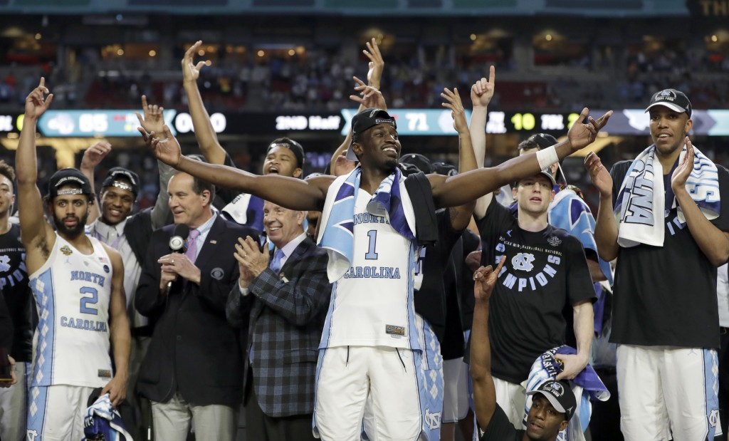 FILE - In this April 3, 2017, file photo, North Carolina's Theo Pinson (1) and the rest of the team celebrate after the championship game against Gonz...