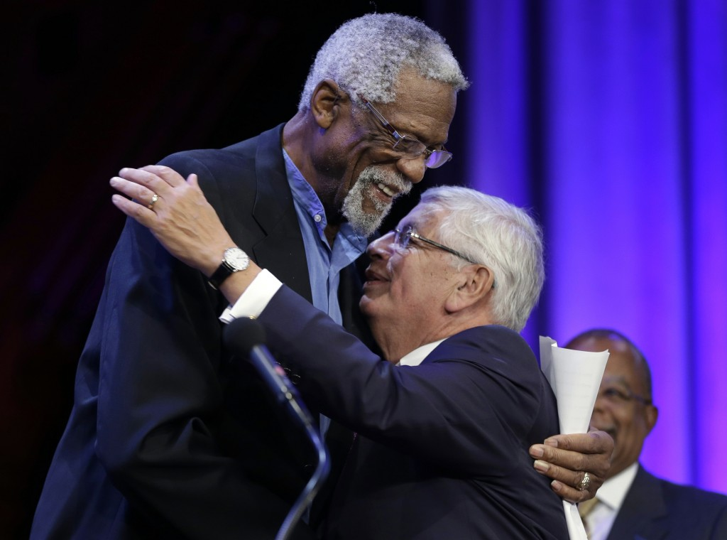 FILE - In this Wednesday, Oct. 2, 2013 file photo, Former Boston Celtics basketball player Bill Russell, left, hugs National Basketball Association Co...
