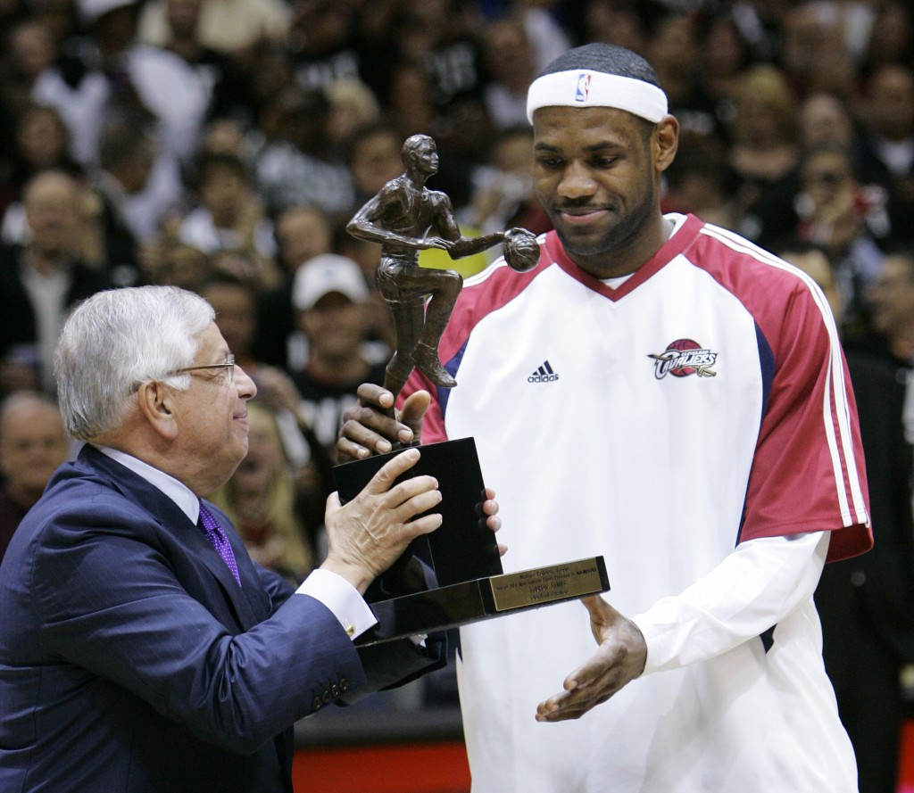 FILE - In this Tuesday, May 5, 2009 file photo, NBA commissioner David Stern, left, presents Cleveland Cavaliers' LeBron James with the 2008-2009 NBA ...