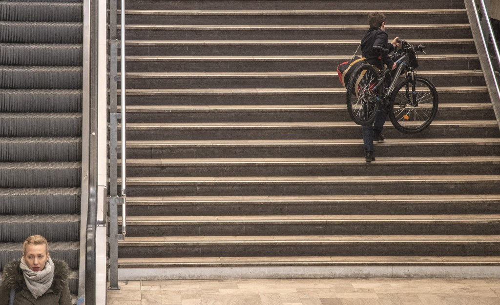 A man carries his bike at at Gare Montparnasse train station during the 29th day of transport strikes in Paris, Thursday, Jan. 2, 2020. The start of 2...