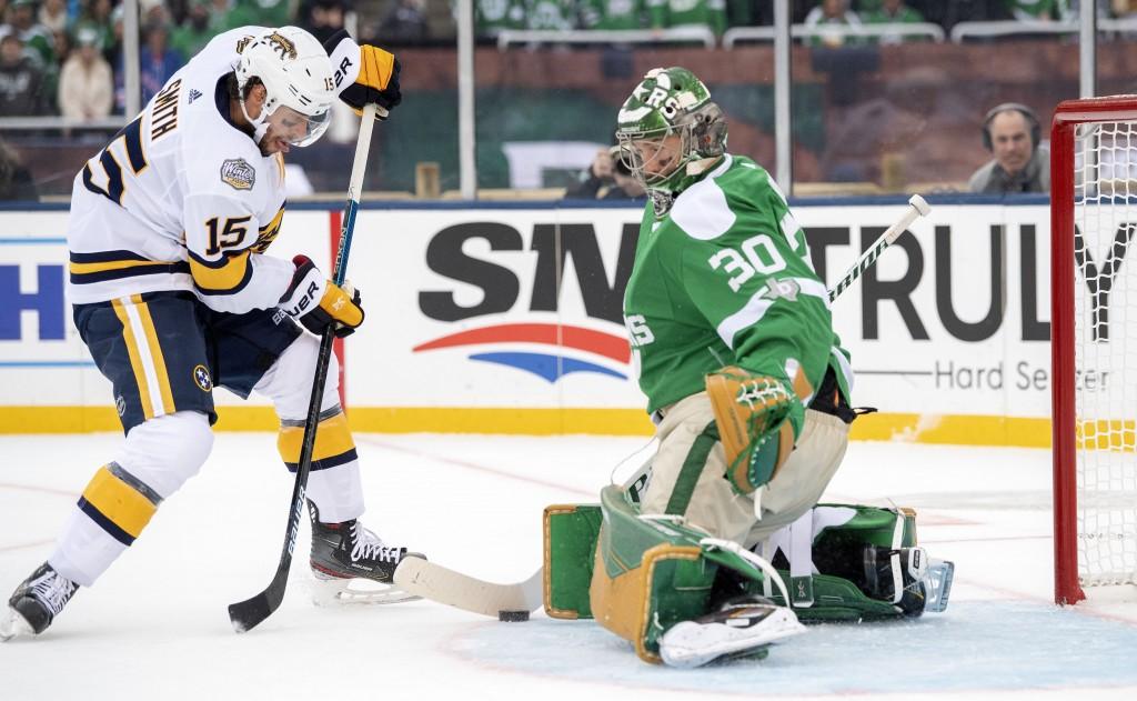 Dallas Stars goaltender Ben Bishop (30) blocks the shot of Nashville Predators right wing Craig Smith (15) in the first period of the NHL Winter Class...