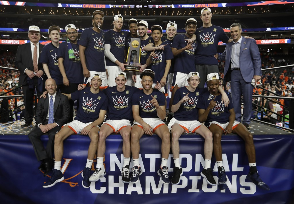 FILE- In this April 8, 2019, file photo, Virginia players celebrate after the championship game against Texas Tech in the Final Four NCAA college bask...