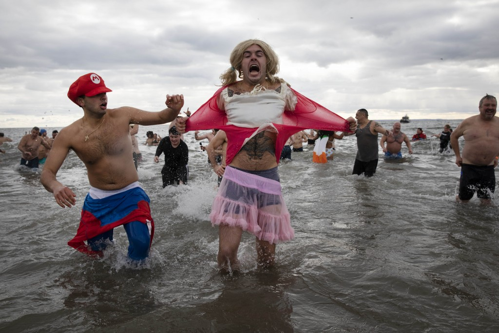 Swimmers jump in the Atlantic Ocean in the annual New Year's Day Coney Island Polar Bear Plunge, Wednesday, Jan. 1, 2020 in the Brooklyn borough of Ne...