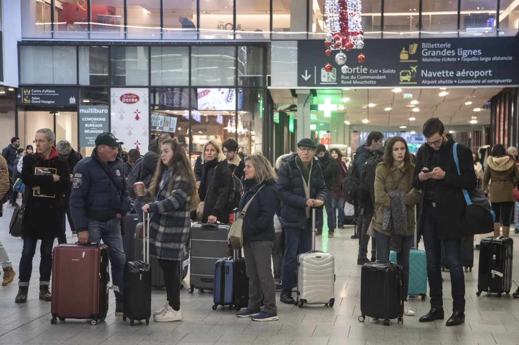Travelers wait at at Gare Montparnasse train station during the 29th day of transport strikes in Paris, Thursday, Jan. 2, 2020. The start of 2020 was ...
