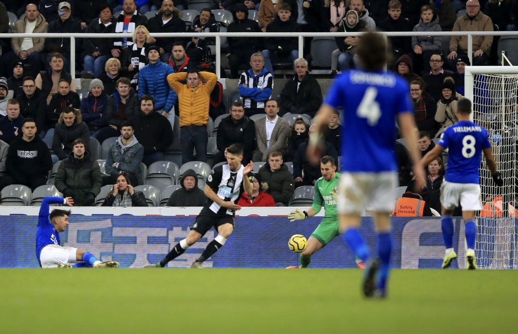 Leicester City's Ayoze Perez, left, scores his side's first goal of the game,  during the English Premier League soccer match between Newcastle United...