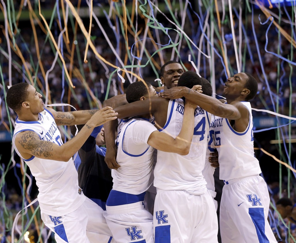 FILE - In this April 2, 2012, file photo, Kentucky players celebrate at the end of the NCAA Final Four tournament college basketball championship game...