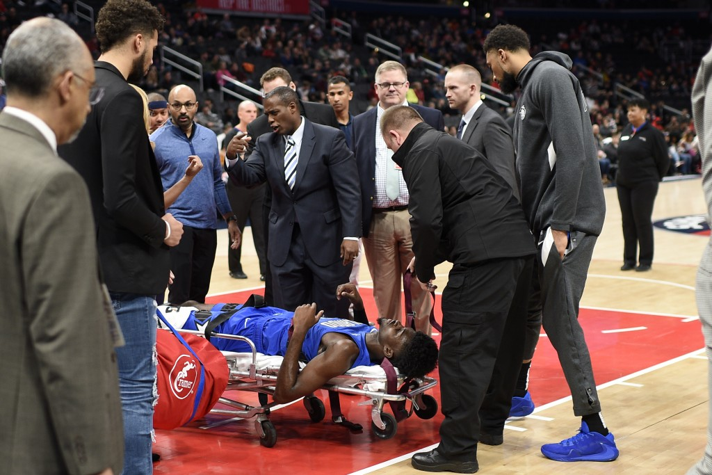 Orlando Magic forward Jonathan Isaac (1) lies on a stretcher after he sustained an injury during the first half of the team's NBA basketball game agai...