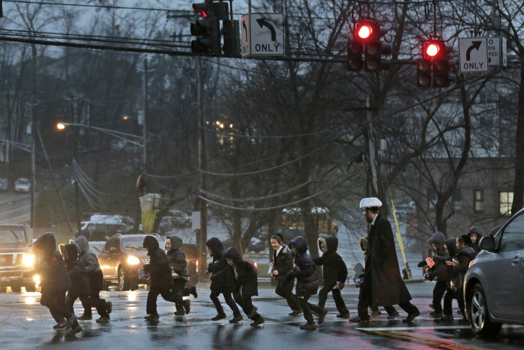 In this Monday, Dec. 30, 2019, photo, a group of orthodox Jewish children cross the street in Monsey, N.Y. With the rapid expansion of Orthodox commun...