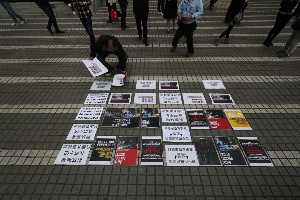 A protester lays out placards in Hong Kong Thursday, Jan. 2, 2020. Hundreds of thousands of people packed Hong Kong streets for an annual New Year's D...