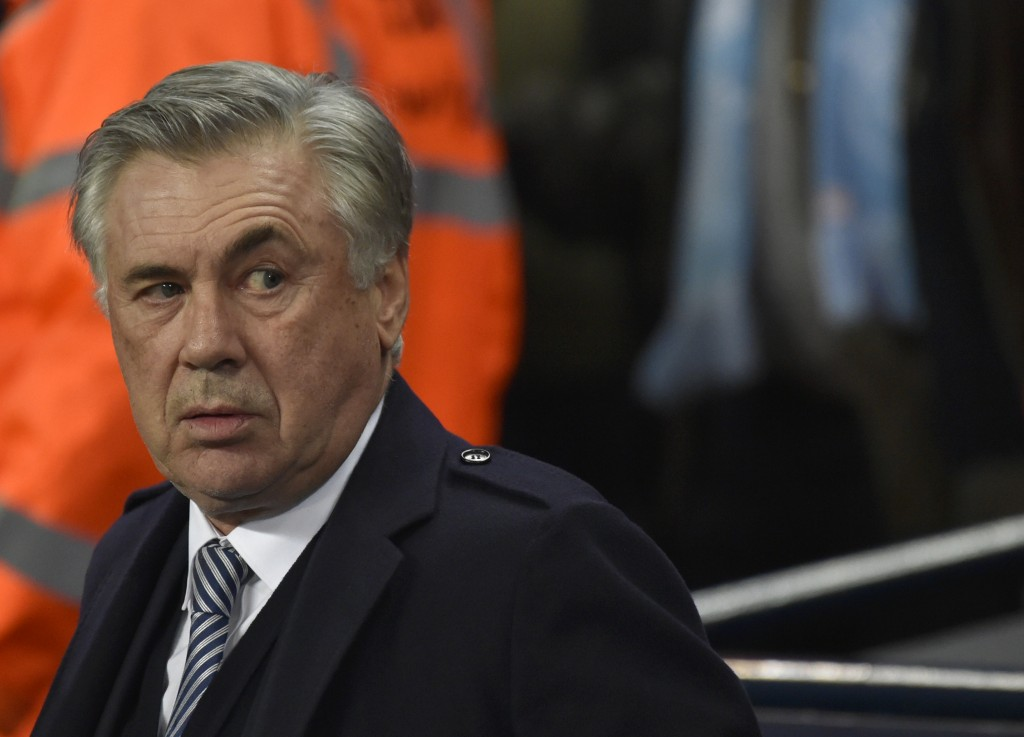 Everton's manager Carlo Ancelotti looks out from the bench before the English Premier League soccer match between Manchester City and Everton at Etiha...