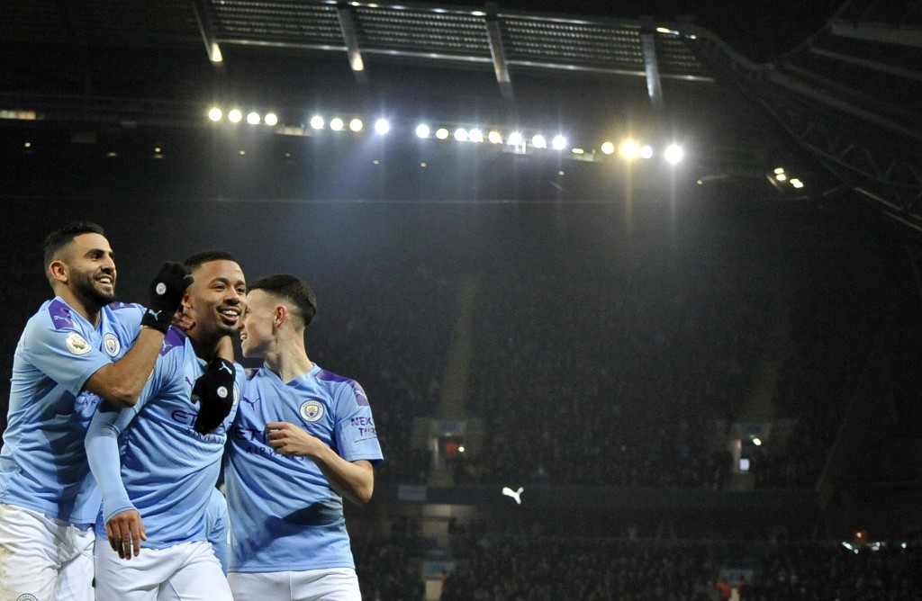 Manchester City's Gabriel Jesus, center, celebrates with teammates after scoring his side's opening goal during the English Premier League soccer matc...
