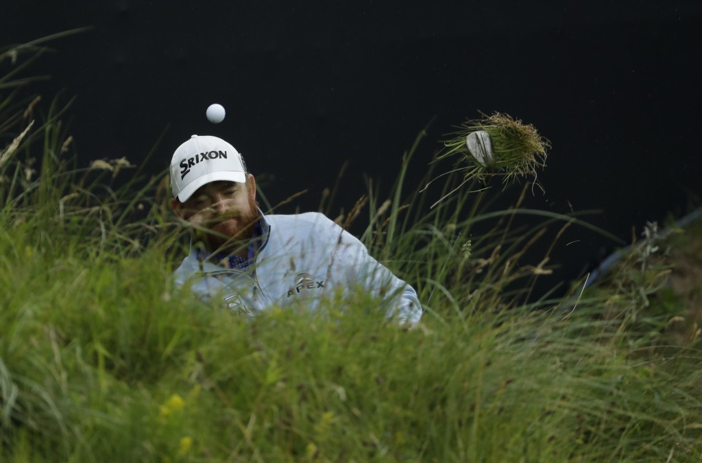 FILE - In this July 21, 2019, file photo, J.B. Holmes, of the United States, chips out onto the 18th green during the final round of the British Open ...