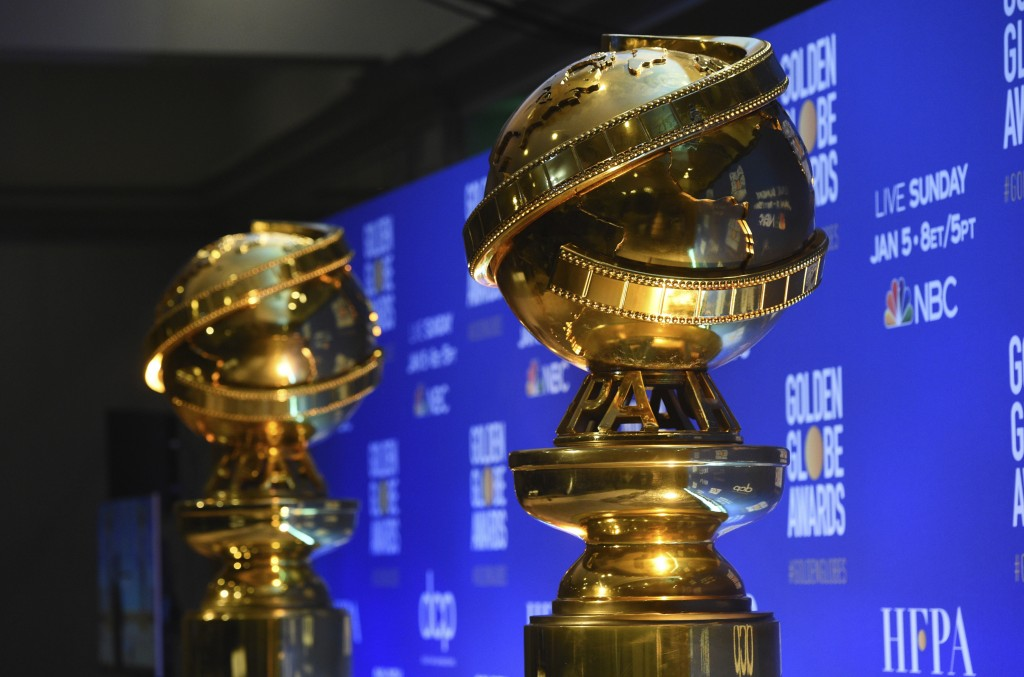 FILE - This Dec. 9, 2019 file photo shows replicas of Golden Globe statues at the nominations for the 77th annual Golden Globe Awards  in Beverly Hill...