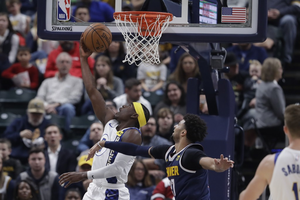 Indiana Pacers' Aaron Holiday (3) shoots next to Denver Nuggets' Jamal Murray (27) during the first half of an NBA basketball game Thursday, Jan. 2, 2...